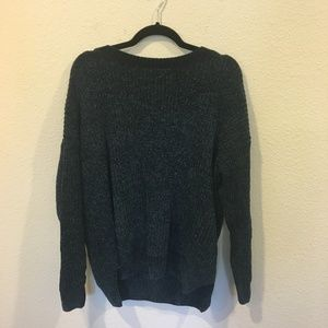 Knit long sleeve sweater with a cut out back